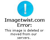Hot Emilia model posing in bed